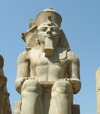 Statue of Pharaoh Ramesses II standing at the Luxor Temple